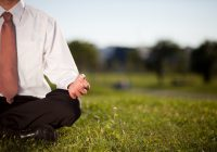bigstock-Businessman-Meditating-In-A-Pa-246814821